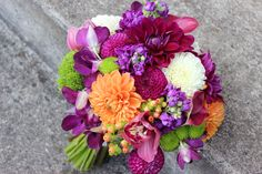 purple orange and green wedding flowers bridal bouquet . roses, orchids, dahlias  roses stock dahlia orchids  http://sophisticatedfloral.com/