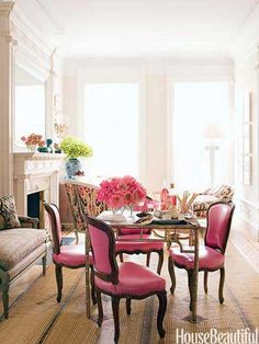 Bright Pink Living Room In the middle of a Brooklyn town house's long, narrow living room, which designer Jonathan Berger broke down into three seating areas, an Italian gilt-brass game table is surrounded by chairs covered in pink leather from Global Leathers. The family dines, plays board games, and does homework here.