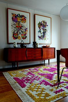 simple shapes of mid century furniture don't compete with pattern & colours of rug & art,  cross stitch pattern rug