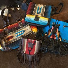 The Museum Store is proud to carry STS Ranchwear handbags! These colorful serape bags will brighten any gloomy fall day and make for a wonderful travel accessory. Check them out in store and online! #stsranchwear #serape #serapebag #handbags #purses #western #westernaccessories #ontrend #fallfashion #fringe #leather