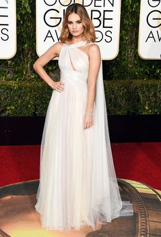 Lily James - Marchesa soft mint, dusty blue, and light purple Grecian hand-draped tulle gown with over-the-shoulder cape detail; Harry Winston jewelry. The Golden Globes Red Carpet Looks You Have to See via @WhoWhatWear