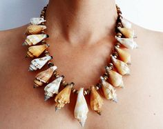 Shell wooden bead necklace. Coconut and wooden beads, brown and white. Pendants of sea shells. Macrame thread.