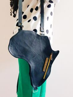 A Vintage Style leather bag designed in the shape of AFRICA. A unisex collection inspired by the diverse beauty, art, culture and people of Africa who continue to inspire the world with Style.