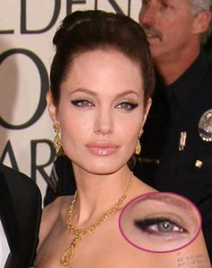 "Get a look like Angelina Jolie's by using a neutral shadow on the lid, then line the entire upper lid and extend the liner up a bit past the eye. ""For a more dramatic approach, make the line thicker towards the outer corner,"" says makeup artist Ashunta Sheriff. Make a very small line on the outer-corner of the lower lashline and finish with mascara"