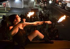 Lisa the Human Candle of Movement Mosaic, fire performing on the roof of the Brick House Brewery in Patchogue, on Long Island. http://www.MovementMosaic.com