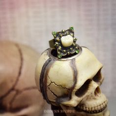 Creepy Molar Ring : antique bronze adjustable ring, peridot Swarovski chatons, and creepy acrylic human tooth, by AnamnesisSyndrome