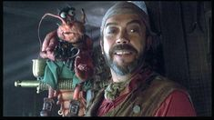 Tim Curry as Long John Silver with pet lobster - Muppet Treasure Island Tim Curry, Statler And Waldorf, Childhood Memories 90s, Long John Silver, Jim Hawkins, Christmas Carol, Muppets Christmas, Labyrinth, Fraggle Rock