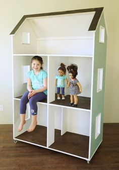 """If you're looking for the coolest ever DIY accessory for American Girl or other 18"""" dolls, you'll definitely want to check out this awesome three story dollhouse project!"""