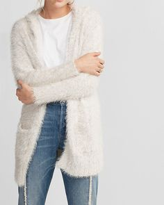 Beat the evening breeze with this elegant, feather-soft cover-up. The roomy fit, patch pockets and cozy hood will see you through from air-conditioned parties to cool upscale nights out.
