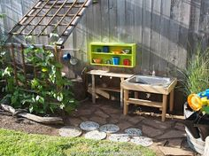 """Outdoor play kitchen - I like the details of this setup: the shelf, the """"floor"""", the trellis alongside to create a shaded space..."""