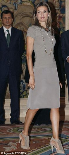 Gorgeous: Princess Letizia hasn't lost her love for grey but knows how to make it work for...