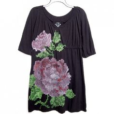 Turn a drab dress into something fabulous by painting on a trendy floral cross-stitch pattern.