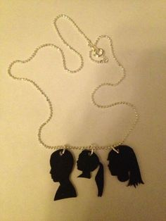 Silhouettes of children into necklace