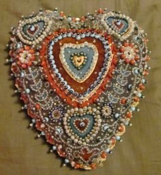 Rare WWI sweetheart Good Luck pincushion dated 1918 with red, white, and blue beads. $375.00, via Etsy.