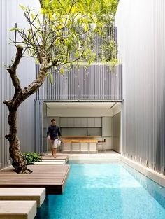 This narrow urban townhouse in New Zealand has made the entire rear garden the swimming pool and has brilliantly created the path to the carriage house to look like huge stepping stones  LOVE IT!