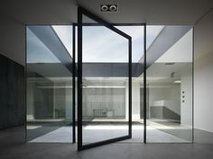 Pivoting window at Kentron HQ – Bologna, Italy by Marco Costanzi architetti Architecture Details, Interior Architecture, Interior And Exterior, Steel Windows, Windows And Doors, Door Design, House Design, Pivot Doors, Modern Door