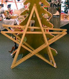 five antique lathe strips assembled together to form a star