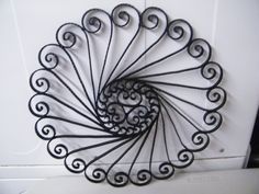ideas to create your own faux wrought iron... this looks like one we can do from paper