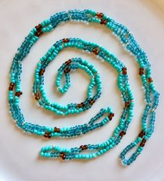 Double strand beaded necklaces that also serve as bracelets when wound round your wrist a few times. Check out the several varieties and other items in my shop. Hippie Jewelry, Beaded Necklaces, Peace And Love, Turquoise Bracelet, Times, Beads, Bracelets, Check, Shopping
