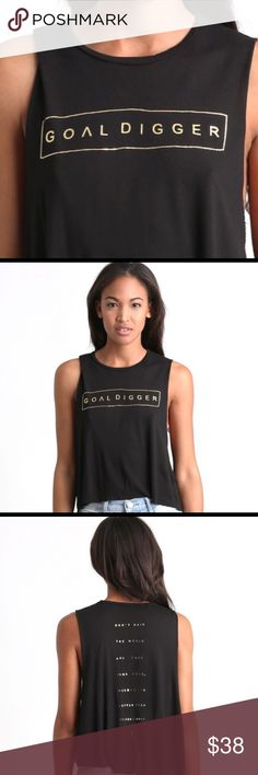 GOALDIGGER black sleeveless w gold foil letters. GOALDIGGER black sleeveless w gold foil letters. Sleeveless / Flyaways run big, so recommended to size down. Material: 95% rayon, 5% spandex. Made in Los Angeles. Neoclassics Tops Tank Tops