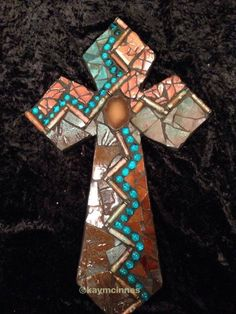 Mixed medium mosaic cross done with stain glass, broken potter, gemstones and gun shell casings www.facebook.com/tinypiecesmakeart