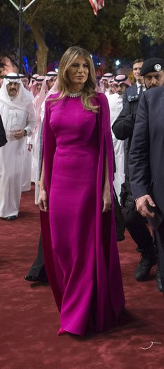 The First Ladies, Melania Trump and Brigitte Macron, brought sophisticated sparkle to the new administration's first State Dinner. Ivanka Trump, Milania Trump Style, Donald And Melania, Purple Gowns, Pink Purple, Conservative Fashion, First Lady Melania Trump, Bold Fashion, Designer Gowns