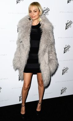 Nicole Richie in a gray faux fur Stella McCartney coat and black mini dress - click ahead for more of the best celebrity winter coats