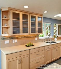 This sleek kitchen design features maple cabinets and Caeserstone counters. This sleek kitchen desig Maple Kitchen Cabinets, Kitchen Countertop Materials, Kitchen Redo, Kitchen Countertops, New Kitchen, Kitchen Backsplash, White Cabinets, Backsplash Ideas, Blue Backsplash