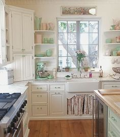 I like the wood floors.  I would skip the marble countertops and replace with a similar color in quartz or butcherblock