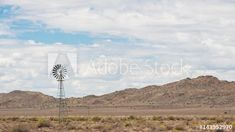 Static daytime timelapse of a windmill blowing in the wind in various directions with fairly thick clouds moving through the scene, casting shadows on the landscape with some blue sky patches and a mountain in the distance available on request Windmill, Stock Video, Geology, Stock Footage, Wind Turbine, Shadows, Distance, South Africa, Adobe
