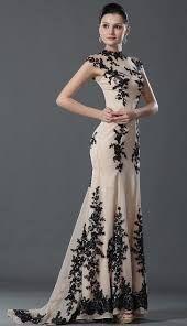 siyah uzun kuyruklu elbiseler ile ilgili görsel sonucu