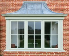 Beautiful sage green bay window in coloured PVC by Frame Force