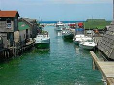 """Leland, Michigan """"Fish town"""" This place holds a very special place in my heart (Just to the left is the gorgeous beach where my husband proposed to me! Cool place to visit Leland Michigan, Detroit Michigan, Lake Michigan, Michigan Travel, State Of Michigan, Northern Michigan, Places To Travel, Places To See, Vacation Places"""