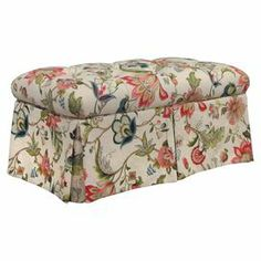 "Button-tufted storage bench with skirted floral upholstery and a pine wood frame. Handmade in the USA.   Product: Storage benchConstruction Material: Pine, metal, fabric and polyurethane foamColor: Brissac jewelFeatures:   Hinged topHandmade in the USA Dimensions: 18"" H x 36"" W x 18.5"" DNote: Assembly requiredCleaning and Care: Spot clean only"
