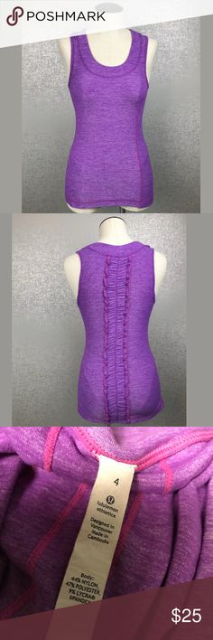 Lululemon Ruffled Tank Lululemon  Size 4 Purple - Lavender  Ruffled Back  Logo on Back Side  Round Neck No Shelf Bra  Excellent Condition  Smoke and pet free home [INVENTORY ID 30A] lululemon athletica Tops Tank Tops