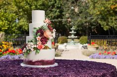 White wedding cake base with painted bottom and 3D flowers   Toni Patisserie & Cafe   Wedding Guide Chicago