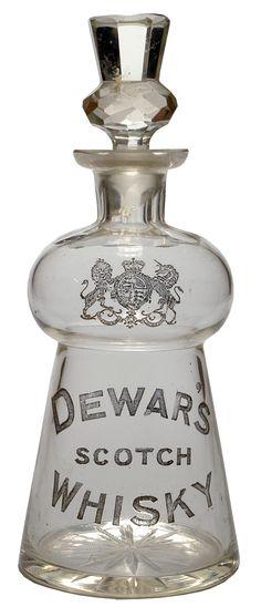 Dewar's Scotch Whisky Decanter. English Coat of Arms. c1900s. Thistle shape & Thistle shape stopper