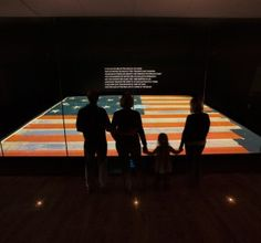 The flag that inspired Francis Scott Key is on display at the Smithsonian National Museum of American History in a display case.