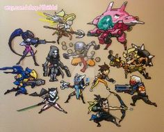 My (almost) complete set of Overwatch sprays I made out of perler beads! This was taken back in Feburary, so I have a couple more done (Mei & Bastion) I'll post pics of those later