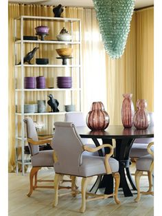 love the upholstered walls and the display of dishes