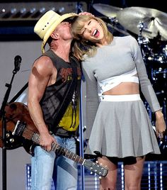 Kenny Chesney and Taylor Swift shared a sweet moment onstage at his Big Revival 2015 tour kick-off on March 26 in Nashville, Tenn.