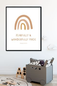 """This adorable """"Fearfully and Wonderfully Made"""" rainbow wall art is perfect to hang in nursery, kids rooms, or playrooms. The neutral and pastel aesthetic pairs well with a neutral modern boho nursery! These printables come as a set of 2."""
