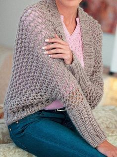 Free Knitting Pattern for Open Lacy Shrug - Lace sweater wrap is knit with a 4-row repeat and sleeves are knit separately and sewn on. Quick knit in bulky yarn. Designed by Elaine van Wyk.