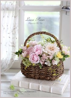 Basket with pink white and yellow flowers