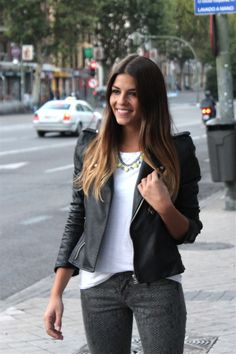 White tshirt, leather jacket & bright yellow necklace