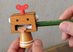 robot sharpener http://www.woodwould.net/products/robot-pencil-sharpener und https://www.etsy.com/listing/226869444/blue-wood-robot-pencil-sharpener