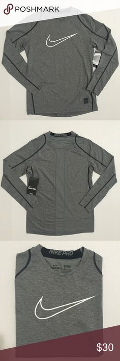 [Nike] PRO DRI-FIT long sleeved top XS-S [Nike] PRO DRI-FIT long sleeved top XS-S •🆕listing •NWT, new with tags condition •heather gray color with white screen logo swoosh on front •may best fit women's XS-S, may be 3/4 sleeved, depending on arm length, tag size is boys L •material 92% polyester 8% spandex, soft athletic stretchy feel •offers and bundles welcomed using the features Nike Tops