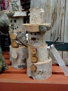 Stack birch logs to make cute snowmen