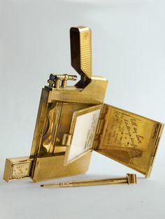 Dunhill women's vanity lighter with watch, ivory tablet, powder case and telescopic pencil. David Golden  - Veranda.com