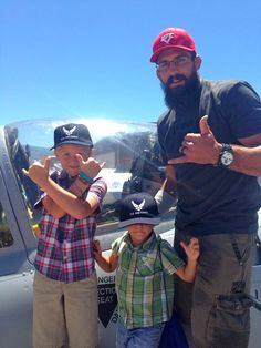 Court [UFC] and his kids infront of the plane.